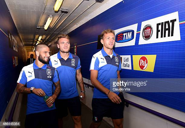 Lorenzo Insigne Ciro Immobile and Domenico Criscito of Italy chat in the players tunnel prior to the UEFA EURO 2016 qualifier between Italy and Malta...