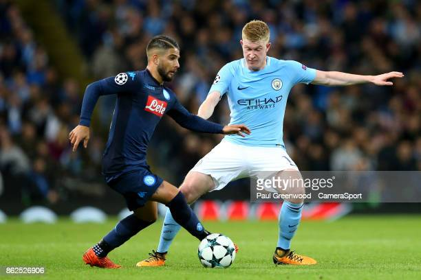 Lorenzo Insigne is tackled by Kevin De Bruyne during the UEFA Champions League group F match between Manchester City and SSC Napoli at Etihad Stadium...