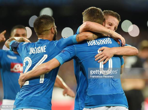 Lorenzo Insigne Jorginho and Dries Mertens of SSC Napoli celebrate the 20 goal scored by Jorginho during the UEFA Champions League Qualifying...