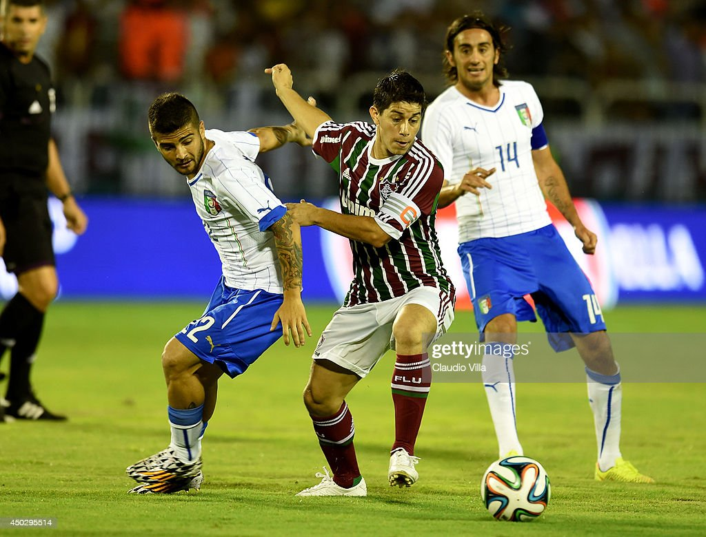 Lorenzo Insigne of Italy and Dario Conca of Fluminense FC compete for the ball during the international friendly match between Italy and Fluminense...