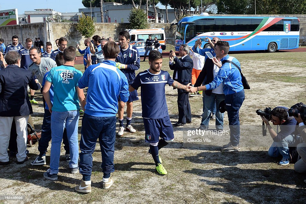 <a gi-track='captionPersonalityLinkClicked' href=/galleries/search?phrase=Lorenzo+Insigne&family=editorial&specificpeople=7486481 ng-click='$event.stopPropagation()'>Lorenzo Insigne</a> of Italy arrives before of a training session, ahead of their FIFA World Cup qualifier against Armenia, on October 14, 2013 in Naples, Italy. The training session was organised at Quarto, a football pitch built on land confiscated from the Camorra - the Neapolitan Mafia, as part of the fight against the mafia.