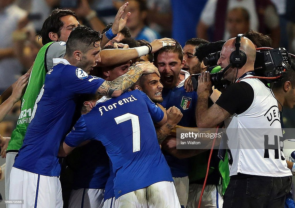 <a gi-track='captionPersonalityLinkClicked' href=/galleries/search?phrase=Lorenzo+Insigne&family=editorial&specificpeople=7486481 ng-click='$event.stopPropagation()'>Lorenzo Insigne</a> of Italy celebrates scoring a goal during the UEFA European U21 Championships, Group A match between England and Italy at the Bloomfield Stadium on June 5, 2013 in Tel Aviv, Israel.