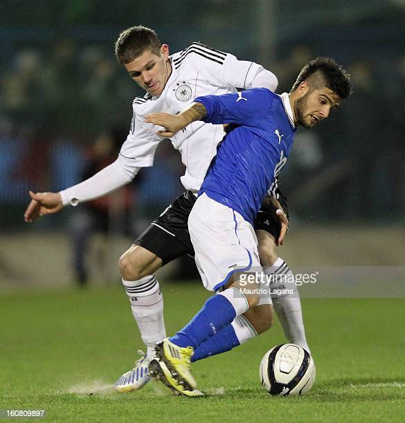 Lorenzo Insigne of Italy competes for the ball with Sebastian Jung of Germany during U21 International Friendly match between Italy and Germany at...