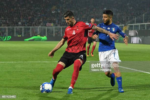 Lorenzo Insigne of Italy competes with Elseid Hysaj of Albania during the FIFA 2018 World Cup Qualifier between Italy and Albania at Stadio Renzo...