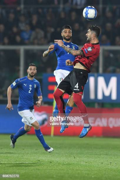 Lorenzo Insigne of Italy goes up with Elseid Hysaj of Albania during the FIFA 2018 World Cup Qualifier between Italy and Albania at Stadio Renzo...