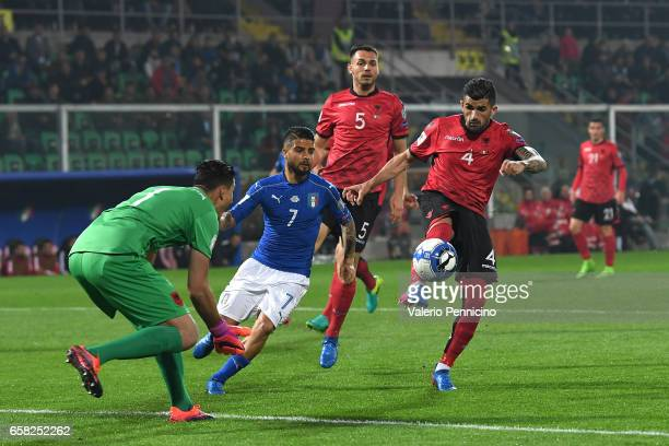 Lorenzo Insigne of Italy is challenged by Elseid Hysaj of Albania during the FIFA 2018 World Cup Qualifier between Italy and Albania at Stadio Renzo...