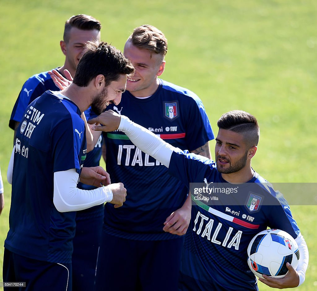 <a gi-track='captionPersonalityLinkClicked' href=/galleries/search?phrase=Lorenzo+Insigne&family=editorial&specificpeople=7486481 ng-click='$event.stopPropagation()'>Lorenzo Insigne</a> of Italy (R) reacts during the Italy training session at the club's training ground at Coverciano on May 25, 2016 in Florence, Italy.