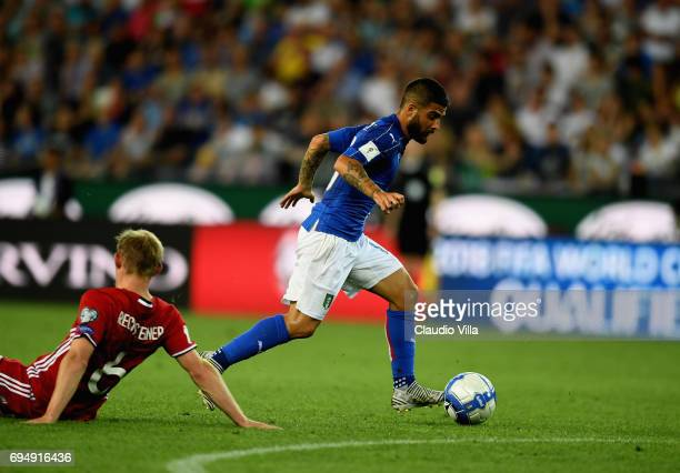 Lorenzo Insigne of Italy scores the opening goal during the FIFA 2018 World Cup Qualifier between Italy and Liechtenstein at Stadio Friuli on June 11...