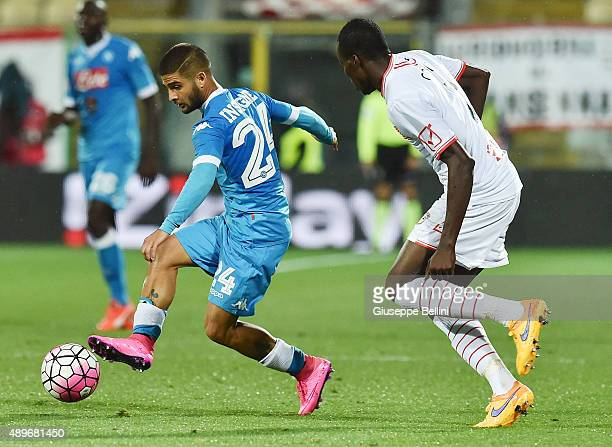 Lorenzo Insigne of Napoli and Isaac Cofie of Carpi in action during the Serie A match between Carpi FC and SSC Napoli at Alberto Braglia Stadium on...