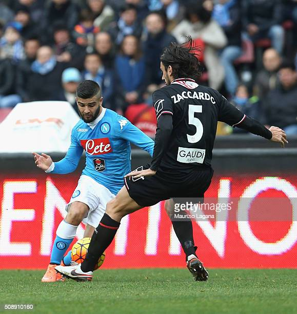 Lorenzo Insigne of Napoli competes for the ball with Cristian Zaccardo of Carpi during the Serie A match between SSC Napoli and Carpi FC at Stadio...