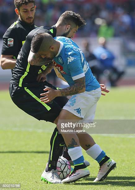 Lorenzo Insigne of Napoli competes for the ball with Eros Pisano of Verona during the Serie A match between SSC Napoli and Hellas Verona FC at Stadio...