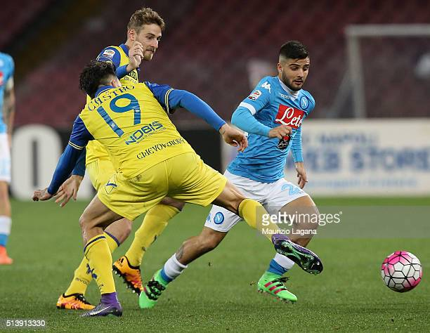 Lorenzo Insigne of Napoli competes for the ball with Lucas Castro of Chievo during the Serie A match between SSC Napoli and AC Chievo Verona at...