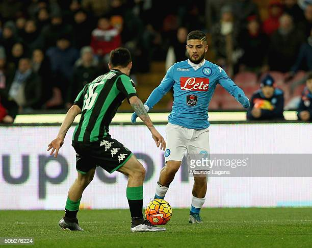 Lorenzo Insigne of Napoli competes for the ball with Matteo Politano of Sassuolo during the Serie A match between SSC Napoli and US Sassuolo Calcio...