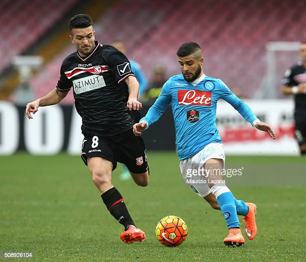 Lorenzo Insigne of Napoli competes for the ball with Raffaele Bianco of Carpi during the Serie A match between SSC Napoli and Carpi FC at Stadio San...