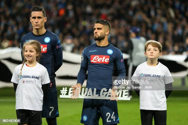 Lorenzo Insigne of Napoli holds a message saying #equalgame during the UEFA Champions League group F match between Manchester City and SSC Napoli at...