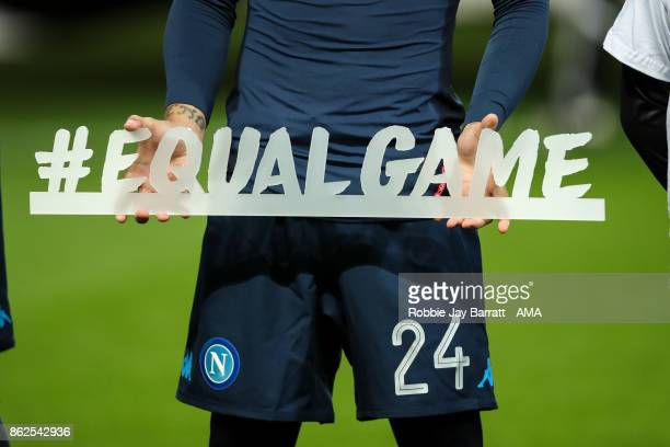 Lorenzo Insigne of Napoli holds a sign which reads Equal Game prior to the UEFA Champions League group F match between Manchester City and SSC Napoli...