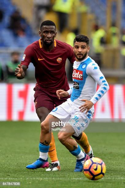 Lorenzo Insigne of Napoli is challenged by Antonio Rudiger of AS Roma during the Serie A match between Roma and Napoli at Stadio Olimpico Rome Italy...
