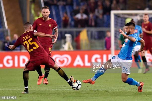 Lorenzo Insigne of Napoli is challenged by Bruno Peres of Roma during the Serie A match between Roma and Napoli at Olympic Stadium Roma Italy on 13...