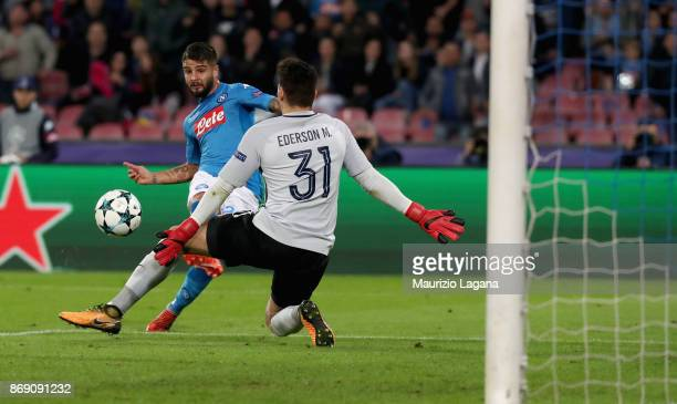 Lorenzo Insigne of Napoli scores his team's opening goal during the UEFA Champions League group F match between SSC Napoli and Manchester City at...