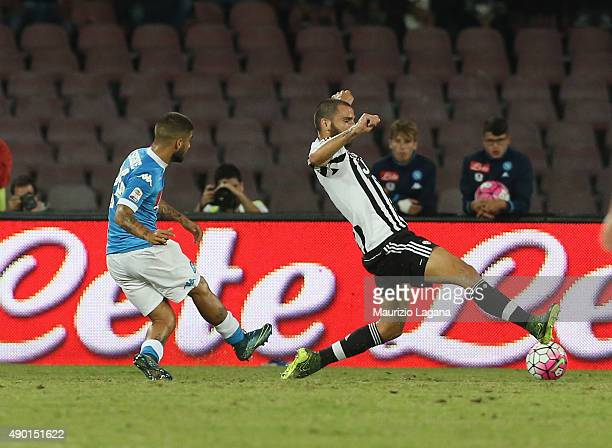 Lorenzo Insigne of Napoli scores the opening goal during the Serie A match between SSC Napoli and Juventus FC at Stadio San Paolo on September 26...