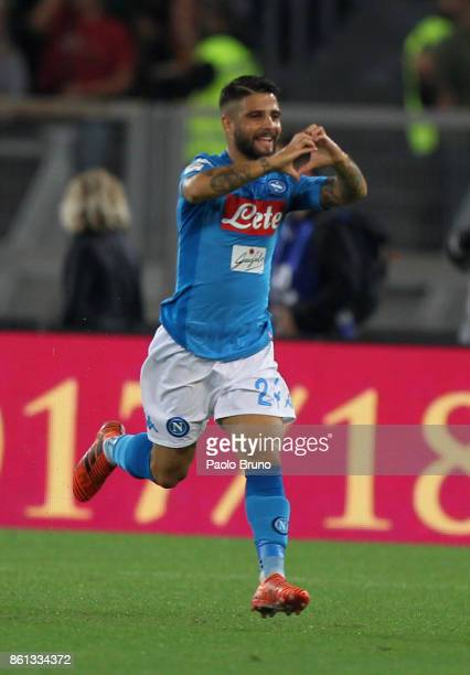 Lorenzo Insigne of SSC Napoli celebrates after scoring the opening goal during the Serie A match between AS Roma and SSC Napoli at Stadio Olimpico on...
