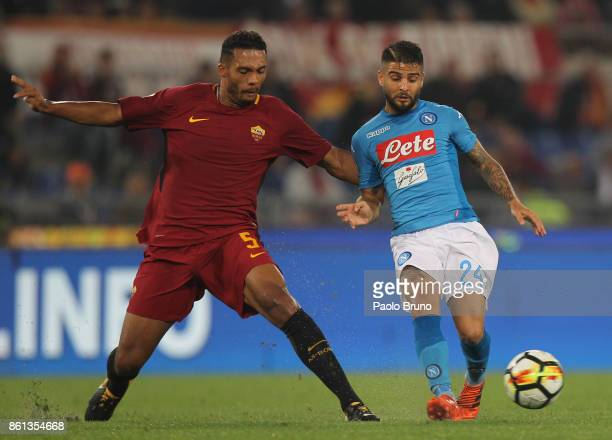 Lorenzo Insigne of SSC Napoli competes for the ball with Juan Jesus of AS Roma during the Serie A match between AS Roma and SSC Napoli at Stadio...