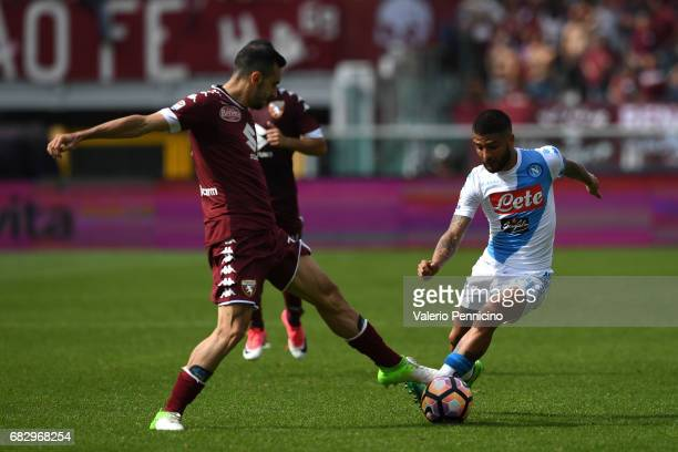 Lorenzo Insigne of SSC Napoli is challenged by Davide Zappacosta of FC Torino during the Serie A match between FC Torino and SSC Napoli at Stadio...