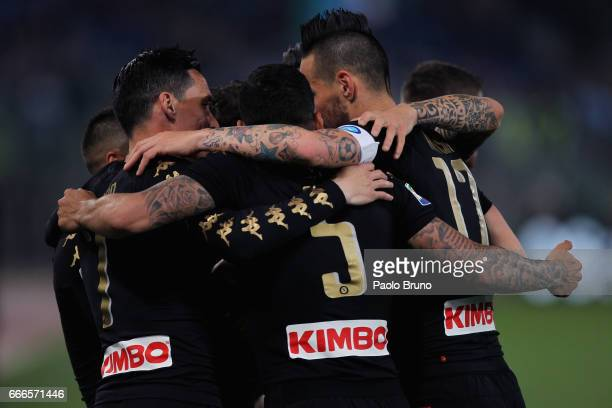 Lorenzo Insigne with his teammates of SSC Napoli celebrates after scoring the team's second goal during the Serie A match between SS Lazio and SSC...