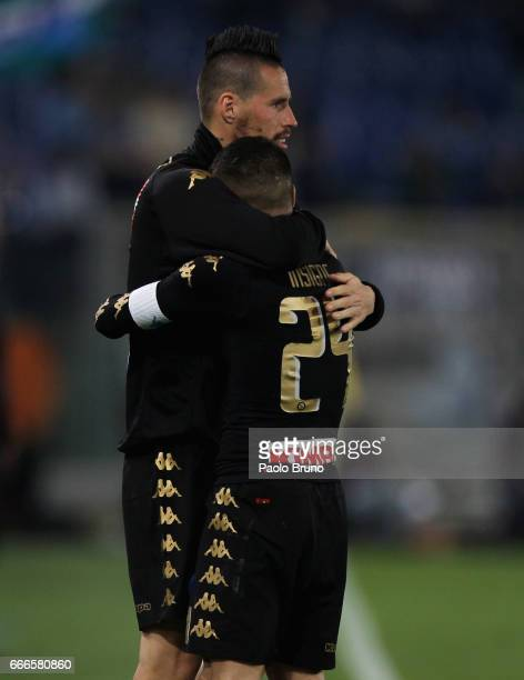 Lorenzo Insigne with Marek Hamsik of SSC Napoli celebrates after scoring the team's third goal during the Serie A match between SS Lazio and SSC...
