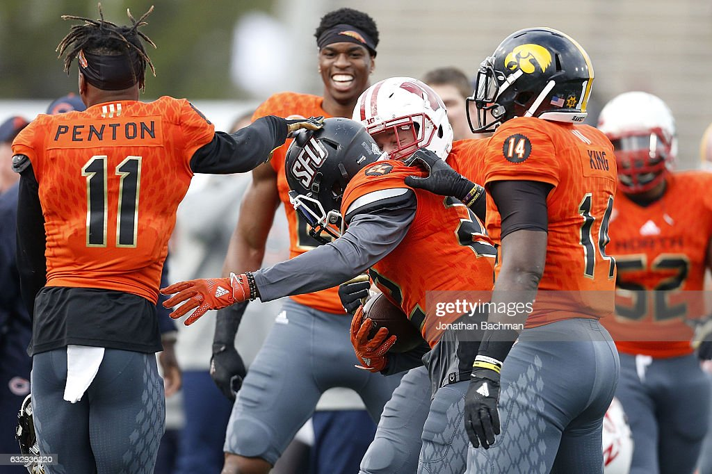 Lorenzo Jerome #22 of the North team celebrates with teammates after catching an interception during the second half of the Reese's Senior Bowl at the Ladd-Peebles Stadium on January 28, 2017 in Mobile, Alabama.