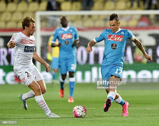Lorenzo Lollo of Carpi and Marek Hamsik of Napoli in action during the Serie A match between Carpi FC and SSC Napoli at Alberto Braglia Stadium on...