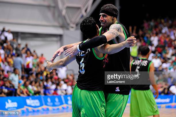 Lorenzo Mata and David Meza of Mexico celebrate during a semifinal basketball match against USA as part of the XVI Pan American Games at CODE Dome on...