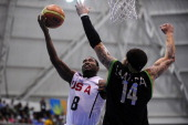 Lorenzo Mata of Mexico and Donald Sloan of USA in action during a semifinal basketball match as part of the XVI Pan American Games at CODE Dome on...