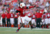 Lorenzo Mauldin of the Louisville Cardinals celebrates after sacking the quarterback during the game against the Wake Forest Demon Deacons at Papa...