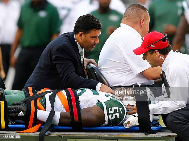 Lorenzo Mauldin of the New York Jets is carted off the field on a stretcher during the fourth quarter against the Cleveland Browns at MetLife Stadium...