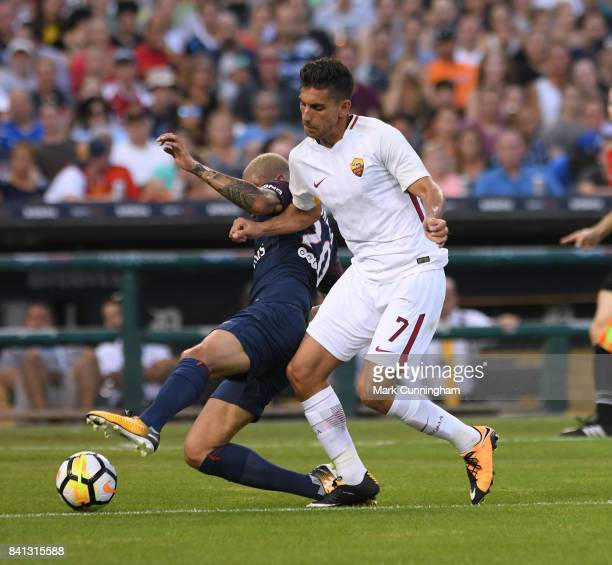 Lorenzo Pellegrini of AS Roma and Layvin Kurzawa of Paris SaintGermain fight for the ball during the International Champions Cup soccer match at...