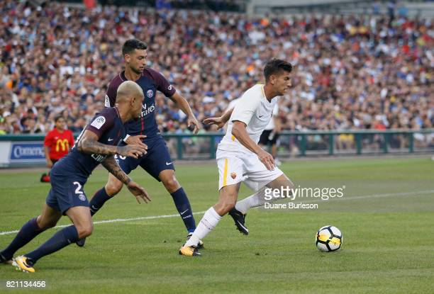 Lorenzo Pellegrini of AS Roma is pursued by Layvin Kurzawa of Paris SaintGermain and Javier Pastore of Paris SaintGermain during the first half at...