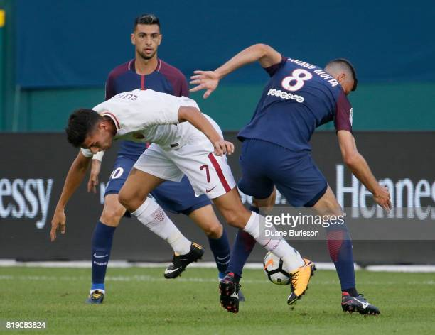 Lorenzo Pellegrini of AS Roma is tripped up as Thiago Motta of Paris SaintGermain tries to steal the ball during the first half at Comerica Park on...