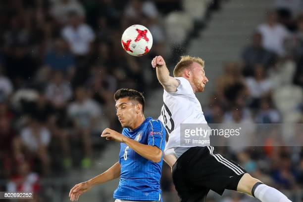 Lorenzo Pellegrini of Italy and Maximilian Arnold of Germany battle for the ball during the UEFA U21 championship match between Italy and Germany at...