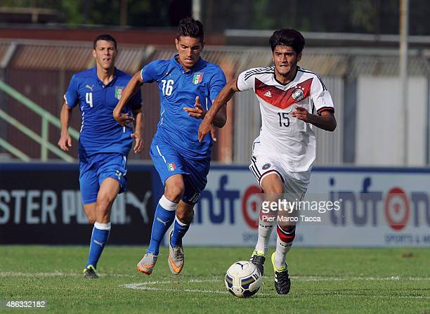Lorenzo Pellegrini of Italy competes for the ball with Edral Ozturk of Germany during the football match U20 Italy and U20 Germany international...