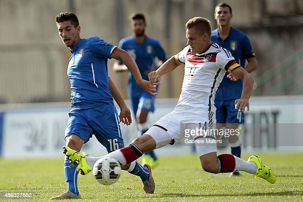 Lorenzo Pellegrini of Italy U20 battles for the ball with Max Cristiansen of Germany U20 during the match between Italy U20 and Germany U20 at Stadio...