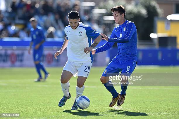 Lorenzo Pellegrini of Italy U21 competes with Gennario Acampora of Italy B during the friendly match between Italy U21 and Italy B on February 10...