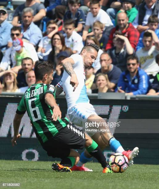 Lorenzo Pellegrini of Sassuolo competes for the ball with Marek Hamsik of Napoli during the Serie A match between US Sassuolo and SSC Napoli at Mapei...