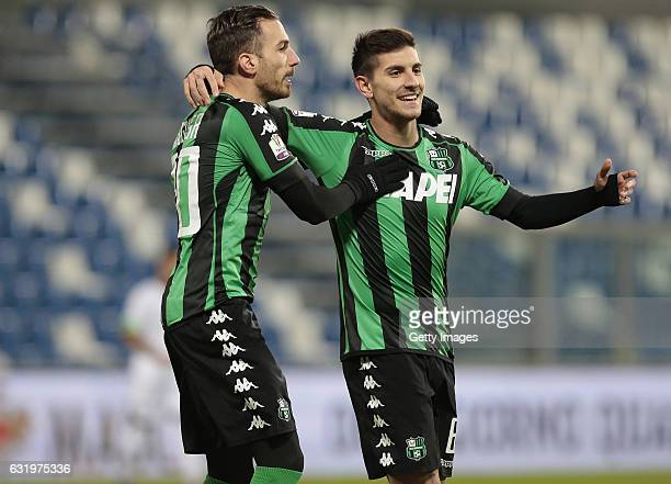 Lorenzo Pellegrini of US Sassuolo Calcio celebrates with his teammates Antonio Ragusa after scoring the opening goal during the TIM Cup match between...