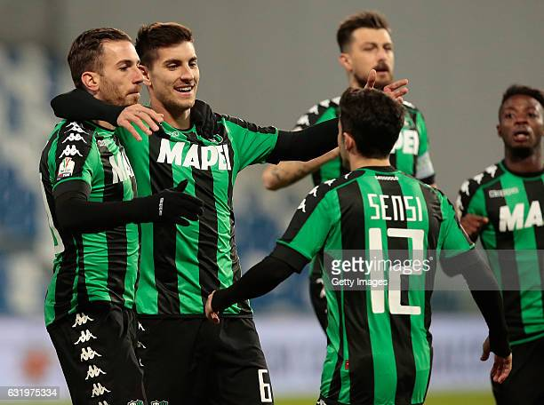 Lorenzo Pellegrini of US Sassuolo Calcio celebrates with his teammate Antonio Ragusa after scoring the opening goal during the TIM Cup match between...