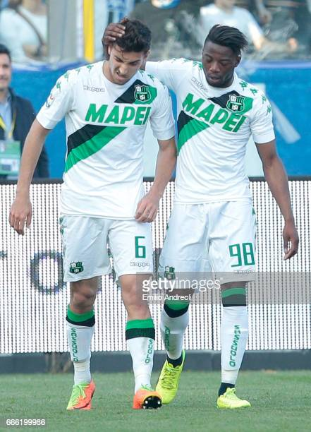 Lorenzo Pellegrini of US Sassuolo Calcio celebrates with his teammate Claude Adjapong after scoring the opening goal during the Serie A match between...