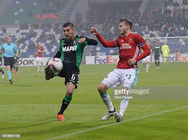 Lorenzo Pellegrini of US Sassuolo Calcio competes with Arnor Ingvi Traustason of SK Rapid Wien during the UEFA Europa League match between US...