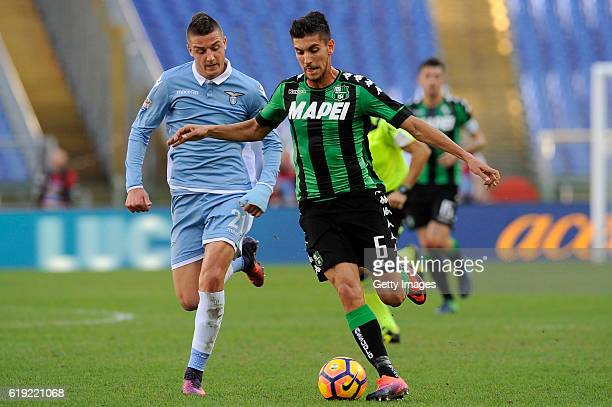 Lorenzo Pellegrini of US Sassuolo competes with Sergej Milinkovic Savic of SS Lazio during the Serie A match between SS Lazio and US Sassuolo at...