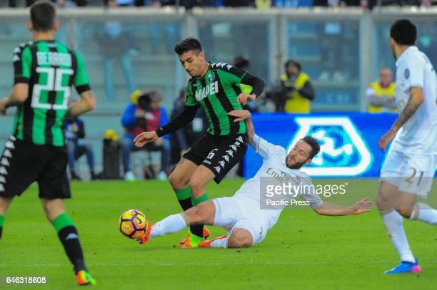 Lorenzo Pellegrini Sassuolo's midfielder and Andrea Bertolacci Milan's midfielder fight for the ball during the serie A football match between US...