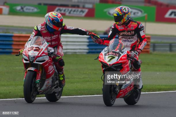 Lorenzo Savadori of Italy and Milwaukee Aprilia congratulates with Chaz Davies of Great Britain and ARUBAIT RACINGDUCATI at the end of the Superbike...